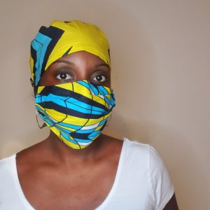 black woman with african print surgical cap and mask