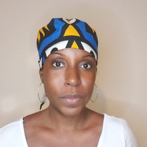 black woman in african print surgical cap