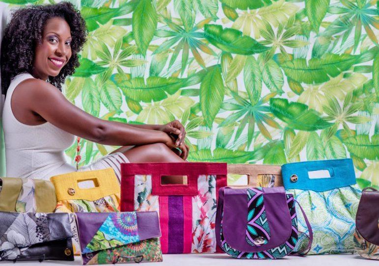 black designer sitting with her black-owned handbag brand